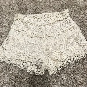 UO High Rise White Lace Shorts